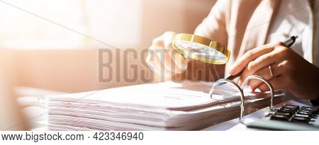 Auditor Woman Using Magnifier Glass For Fraud Investigation