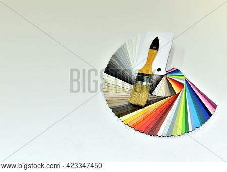 Color Palette Swatches With Paint Brush. Palette Of Different Colors And Shades On White Background.