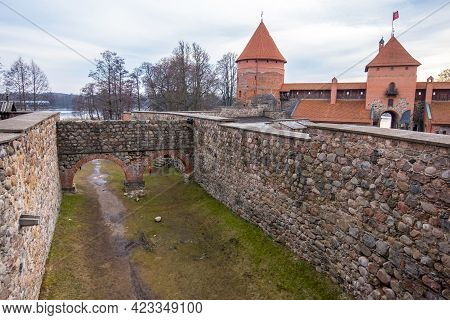 Trakai, Lithuania - February 16, 2020: Medieval Gothic Island Castle With Stone Walls And Towers Wit