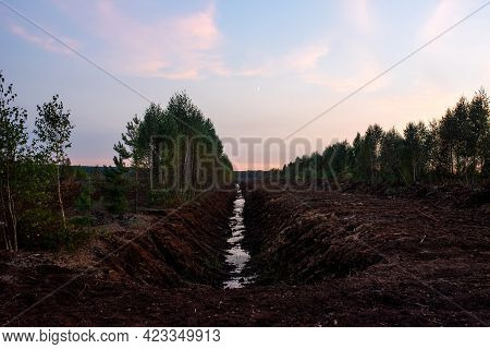 Drainage Ditch In The Peat Extraction Site. Drainage And Destruction Of Peat Bogs. Drilling On Bog F