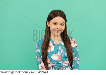 All The Taste Of Being A Girl. Happy Girl Child Smile Blue Background. Girlhood And Childhood