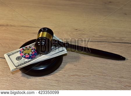 Judge Hammer And Poker Chip For Casino Game On Bundles Of Dollars. Concept Of A Court Decision In A