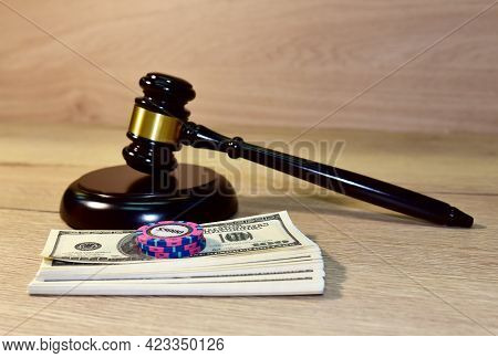 Judge Hammer And Poker Chip For Casino Game On Bundles Of Dollars. Justice Courtroom. Court Decision