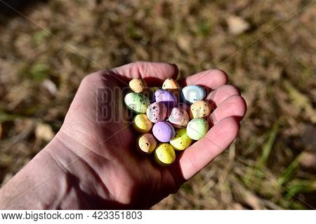 Multicolored Easter Eggs In A Man's Hand. Easter Is A Christian Holiday That Celebrates The Belief I