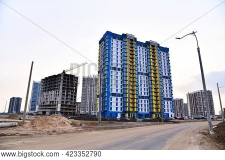Facade Of A New Modern High-rise Residential Building. Tower Crane On Construction Of A Residential
