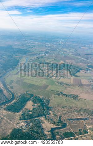 Aerial View From Airplane Window Above Green Ground. View From The Airplane Window With Beautiful Cl