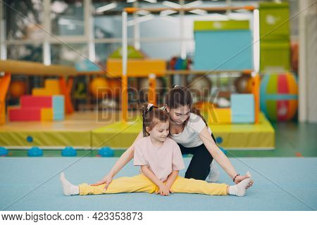Kids Doing Split And Stretching Exercises In Kindergarten Or Elementary School. Children Sport And F