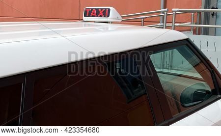Taxi Car Waiting For Customers. Taxi Cab Sign On Top Of The Car. Transportation Of Passengers. Bolog