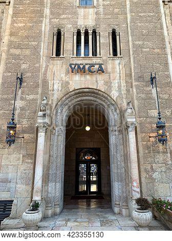 Jerusalem, Israel - March 08, 2021: Entrance To The Building Of Jerusalem International Ymca - Young