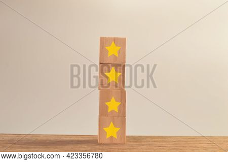 Wooden Blocks With Yellow Stars. Excellent Business Services Rating Customer Experience Concept.