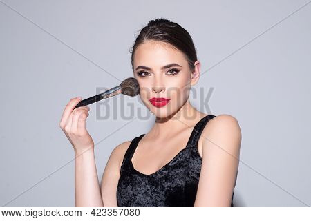 Beautiful Young Woman With Clean Fresh Skin. Beautiful Brunette Young Woman Applying Powder On Her C