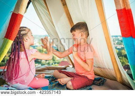 Brother And Sister Playing Together. Happy Kids Family Playing In Tent. Cute Kids Camping. Having Fu