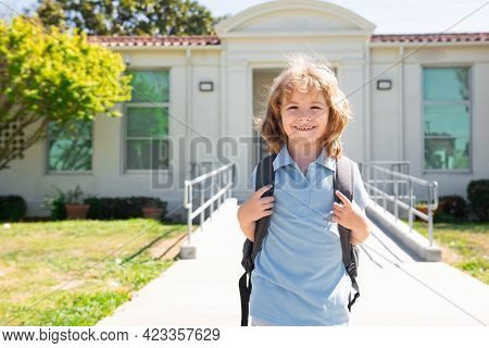 Child Pupul With Rucksacks In The Park Near School. Schoolboy With Backpacks Outdoors.