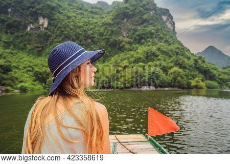 Woman Tourist In Trang An Scenic Landscape Complex In Ninh Binh Province, Vietnam A Unesco World Her