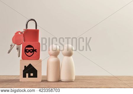 Wooden Doll Figures With Padlock, Scammer And Home. Real Estate Scam Concept.