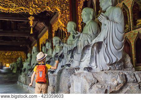 Boy Tourist In Temple Tower Of Bai Dinh Pagoda In Ninh Binh, Vietnam. Resumption Of Tourism In Vietn