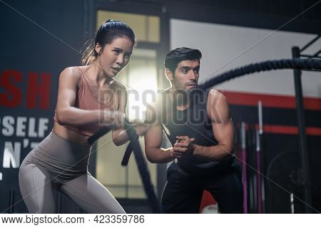 Caucasian Fitness Trainer Or Instructor Instruct And Motivate Young Active Beautiful Sport Girl Usin