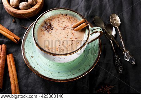 Cup Of Traditional Indian Tea With Milk And On A Linen Tablecloth, Top View. Masala Chai Close Up