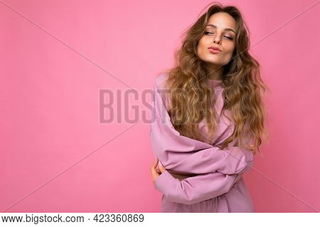 Young Beautiful Curly Blonde Woman With Sexy Expression, Cheerful And Happy Face Wearing Trendy Pink