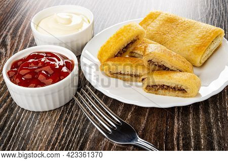 Bowls With Mayonnaise And Ketchup, Whole Pancake Roll, Pieces Of Fried Pancake With Meat Filling In