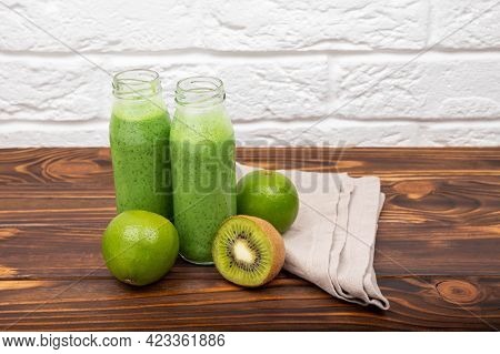 Spinach Milkshake On A Light Background. Fresh Green Smoothie With Cereals. Green Cocktail Spinach S