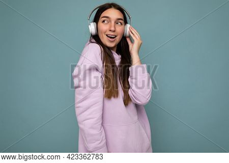 Beautiful Happy Smiling Young Brunette Female Person Wearing Light Purple Hoodie Isolated Over Blue
