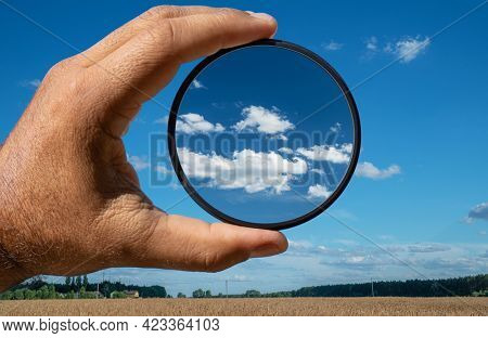 Effect of a polarizing filter shown on the photo of the sky. The picture of the clouds is higher contrast through the filter.