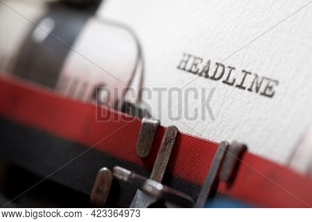 The word headline written with a typewriter.