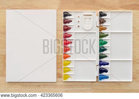 Watercolor Paints Set With White Paper. Bright Multicolored Aquarelle Paints For Art Background.