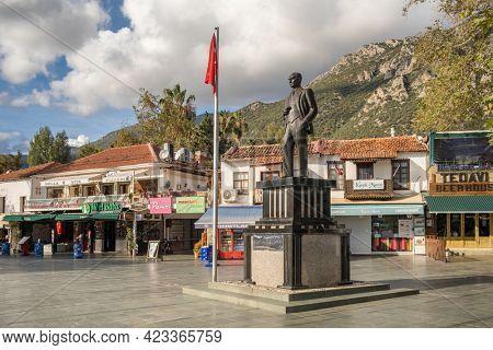 Kas, Turkey - December 2, 2020: Statue of Mustafa Kemal Ataturk, founder of Turkish Republic at the main square of mediterranean town Kas in Turkey.