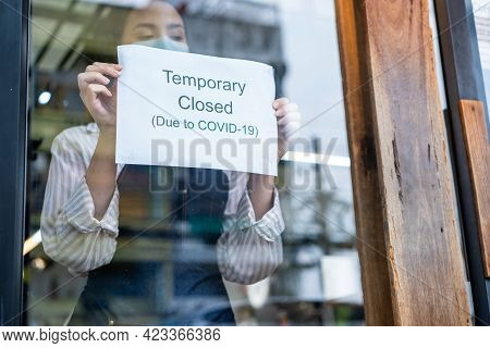 Caucasian Coffee Shop Owner Or Waitress Wear Mask To Prevent From Coronavirus, Turns Temporary Close