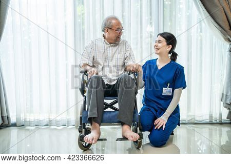 Portrait Of Happy Asian Disabled Senior Elderly Male On Wheelchair Enjoy Stay Home Nursing Care. Bea