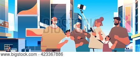Multigenerational Family Using Selfie Stick And Taking Photo On Smartphone Camera People Walking Out