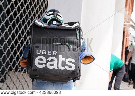 Bordeaux , Aquitaine France - 06 06 2021 : Uber Eats Biker Deliver Man With Large Back Pack On Deliv