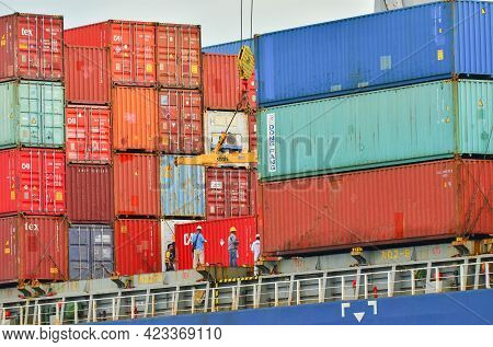 Labuan,malaysia-may 20,2021: Stacked Containers On Cargo Ship Deck Being Unloaded In The Port Of Lab