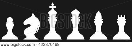 Chessmen. White Chess Pieces Icon On A Black Background. Vector Illustration. Vector.