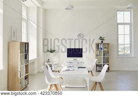 Interior Of Cozy Light Boardroom With Big Table, Modern Chairs And Desktop Computer
