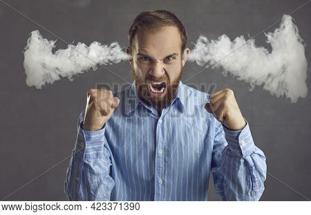 Angry Business Man Shouting With Steam Coming Out Of Ears Isolated On Grey Background