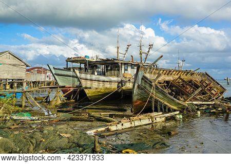 Old Abandoned Wooden Fishing Boats On The Pasir Putih Beach,sandakan,sabah,malaysia.