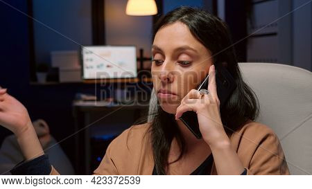 Exhausted Entrepreneur Discussing Management Graphs Gesturing During Negotiations Phone Call Working