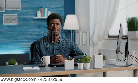 Portrait Of Charming Handsome African American Man Smiling To Camera, Young Black Man In Cozy Modern