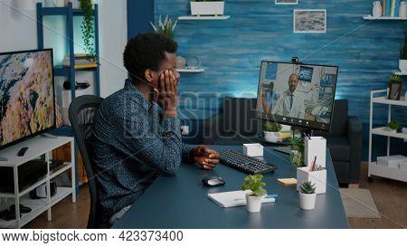Black Man With Toothache Seeking Medical Stomatologist Health Advice Via Internet Video Call Communi