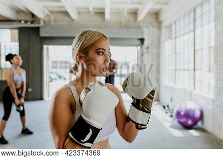 Muscular sportive women at the gym