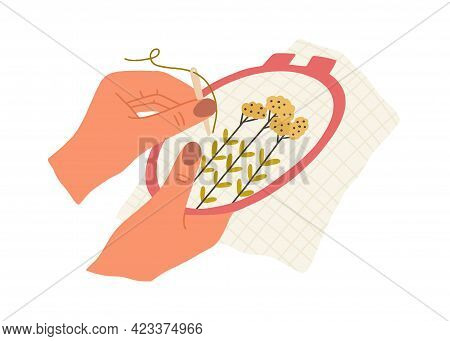 Hand With Needle And Thread Embroidering Flowers On Canvas In Embroidery Hoop. Creation Of Handmade