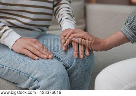 Psychotherapist Holding Patient's Hand Indoors, Closeup View