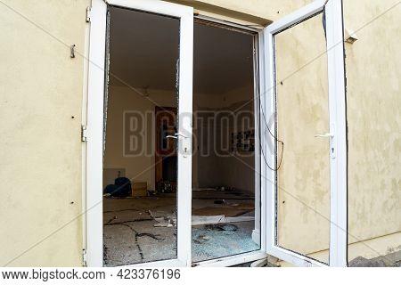 Broken Glass After Break In At Glas Door.