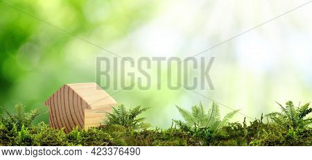 Eco Friendly Home. House Model On Green Grass Outdoors, Banner Design With Space For Text