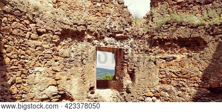 Ruins Of An Old Fortress In Vrdnik, Sremska Mitrovica, Vojvodina, Serbia. Ancient Stone Walls With M