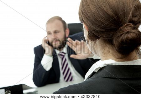Business Man And Woman At Desk Sign Quiet On Phone