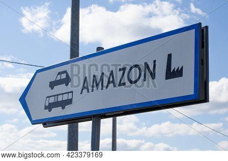 Poland, Sady - May 05, 2021: Information Board In The Amazon Warehouse Parking Lot. E-commerce Job